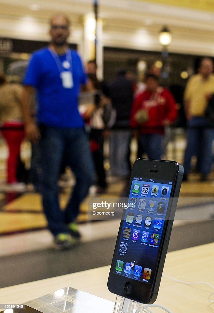 An Apple Inc. iPhone 5 sits on display inside the Apple store at the Gran Plaza 2 shopping mall in Majadahonda, near Madrid, Spain, on Friday, Sept. 28, 2012. Apple said it is working to catch up with demand, 'We are working hard to get an iPhone 5 into the hands of every customer who wants one as quickly as possible,' Apple Chief Executive Officer Tim Cook said in a statement. Photographer: Angel Navarrete/Bloomberg via Getty Images