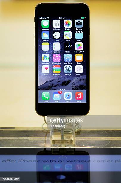 An Apple Inc. IPhone 6 stands on display during the sales launch of the iPhone 6 and iPhone 6 Plus at the company's George Street store in Sydney,...