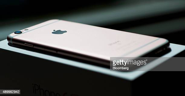 An Apple Inc iPhone 6s smartphone sits on a packaging box in an arranged photograph in Hong Kong China on Friday Sept 25 2015 The latest models...