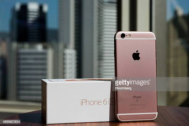 An Apple Inc iPhone 6s smartphone stands next to a packaging box in an arranged photograph in Hong Kong China on Friday Sept 25 2015 The latest...