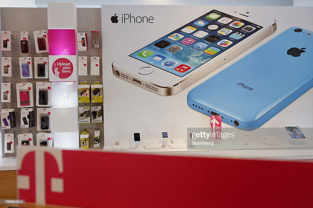 An Apple Inc Iphone Advertisement Is Displayed At A T Mobile Us Inc