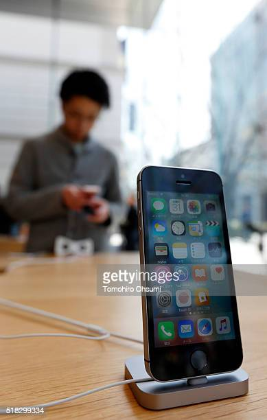 An Apple Inc iPhone SE is displayed at the company's Omotesando store on March 31 2016 in Tokyo Japan Apple Inc launched its iPhone SE and iPad Pro...