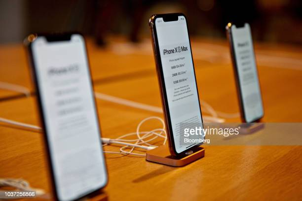 An Apple Inc iPhone XS Max center and iPhone XS smartphones sit on display during a sales launch at a store in Chicago Illinois US on Friday Sept 21...