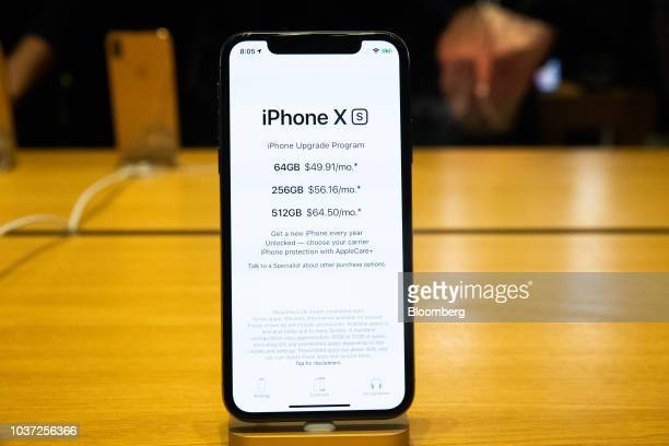 Customers browse Apple Inc smartphone cases during a sales launch at a store in Chicago Illinois US on Friday Sept 21 2018 The iPhone XS is up to...