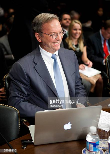 An Apple Inc laptop computer sits on the witness table in front of Eric Schmidt chairman of Google Inc as he waits to testify before the Senate...