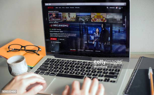 An Apple Inc laptop displays the home screen for the Netflix Inc original series 'The Mechanism' in an arranged photograph taken in Sao Paulo Brazil...