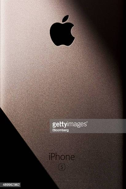 An Apple Inc logo and an iPhone 6s branding are seen on an iPhone 6s smartphone in an arranged photograph in Hong Kong China on Friday Sept 25 2015...