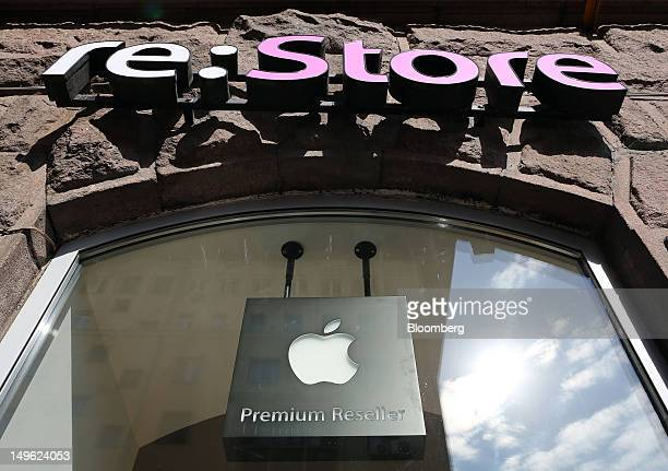 An Apple Inc logo hangs in the window of a reStore a premium Apple product reseller in Moscow Russia on Wednesday Aug 1 2012 OAO Mobile TeleSystems...