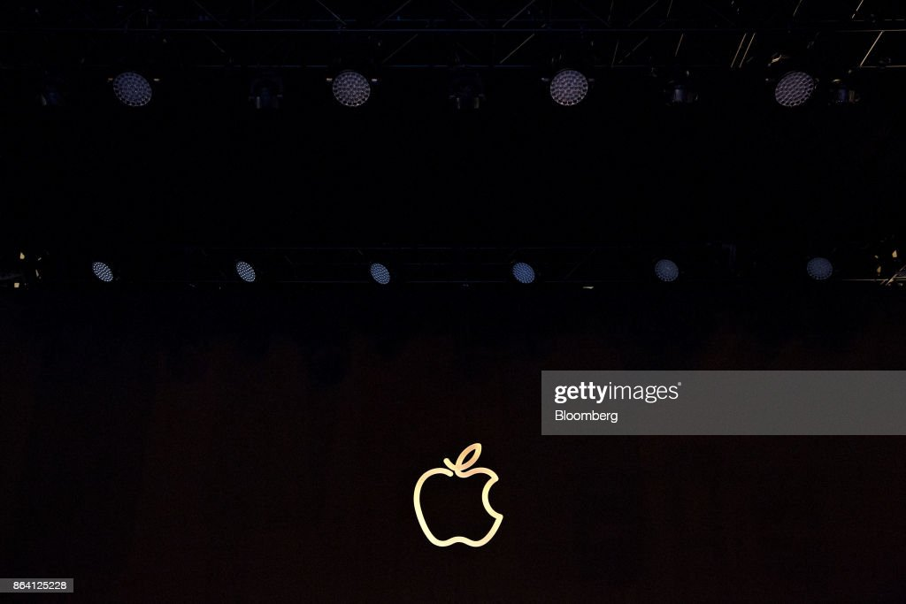 An Apple Inc. logo is illuminated outside the new Apple Inc. Michigan Avenue store in Chicago, Illinois, U.S., on Friday, Oct. 20, 2017. The building features exterior walls made entirely of glass with four interior columns supporting a 111-by-98 foot carbon-fiber roof, designed to minimize the boundary between the city and the Chicago River. Photographer: Daniel Acker/Bloomberg via Getty Images
