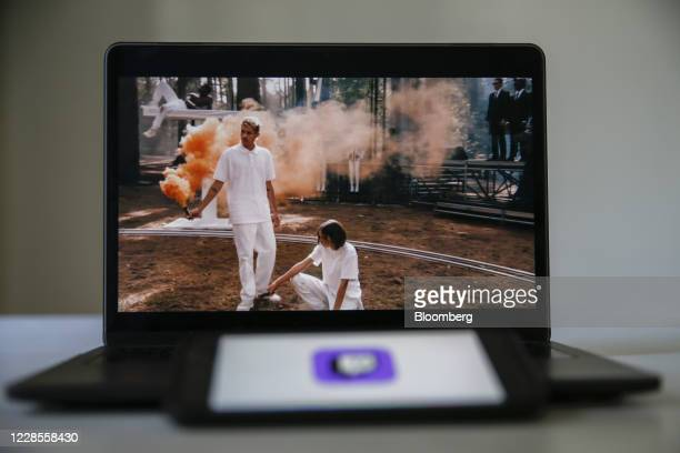 An Apple Inc. MacBook Pro laptop computer displays a livestream broadcast of the Burberry Group Plc Spring/Summer 2021 fashion show live streamed on...