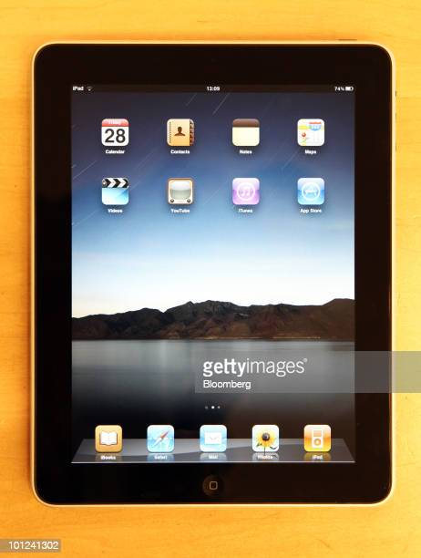 An Apple Inc tablet computer sits on display at the Apple store in central London UK on Thursday May 27 2010 Following the sale of one million of the...