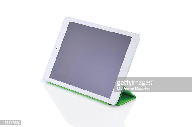 An Apple iPad Air with Smart Cover photographed on a white background taken on November 6 2013