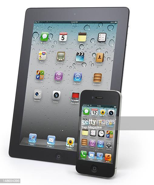 An Apple iPad and iPhone 4S smartphone photographed during a studio shoot for Tap Magazine November 4 2011