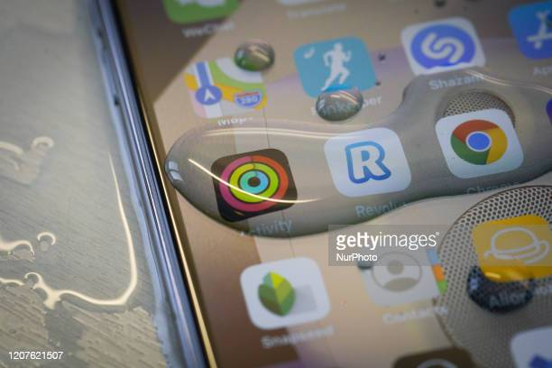 An Apple iPhone 11 Pro Max is seen covered in water droplets after being washed in Warsaw Poland on March 18 2020 Health authorities have advised...