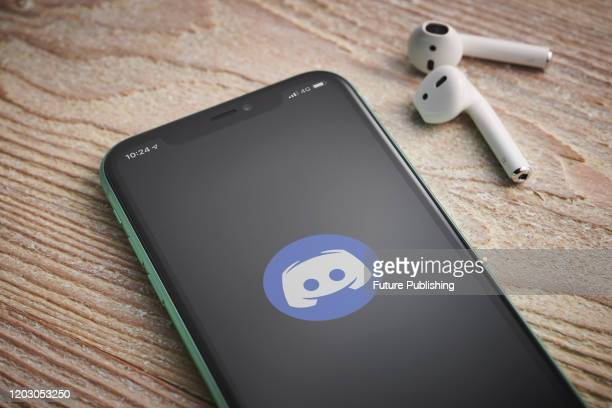 An Apple iPhone 11 smartphone with the Discord software app logo on screen taken on January 27 2020