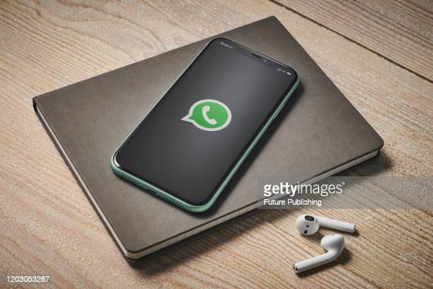 An Apple iPhone 11 smartphone with the WhatsApp instant messaging app logo on screen, taken on January 27, 2020.