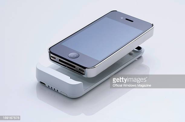 An Apple iPhone 4S and Nuu ClickMate PowerPlus detachable battery photographed during a studio shoot for Official Windows Magazine June 6 2012