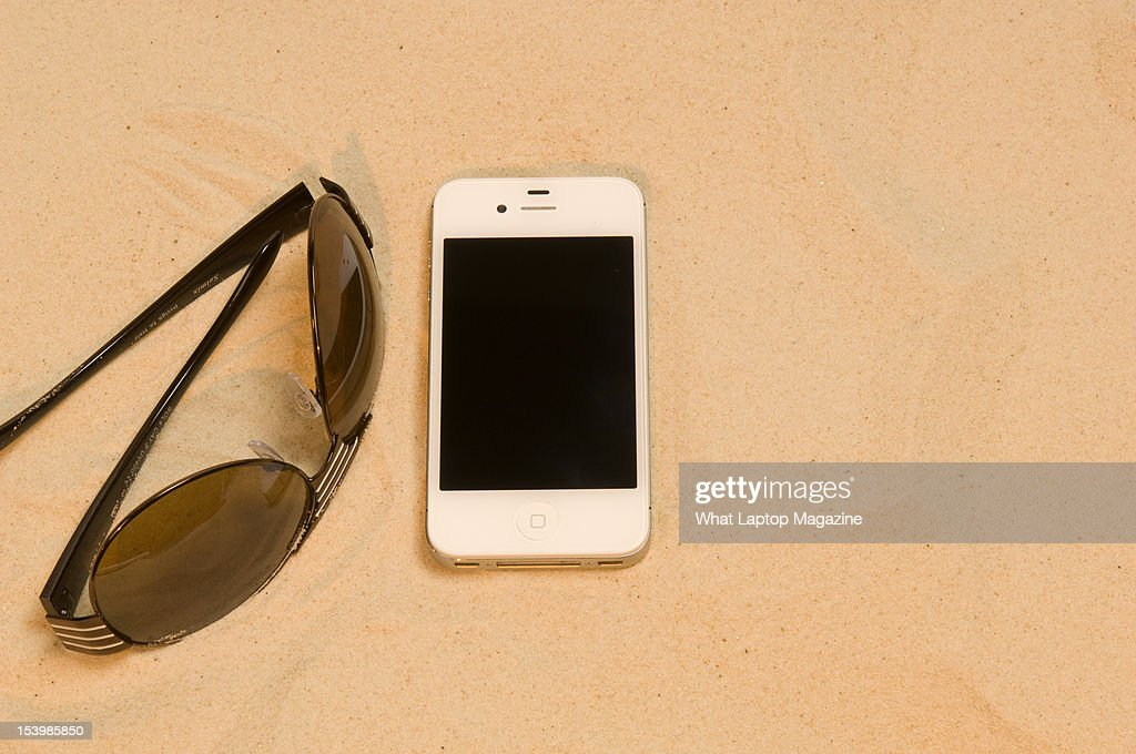 An Apple iPhone 4S, shot in a beach scenario during a holiday technology feature, February 6, 2012.
