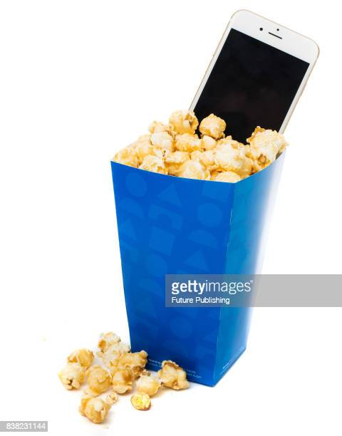 An Apple iPhone 6 smartphone with a Gold finish photographed in a carton of popcorn taken on April 145 2015
