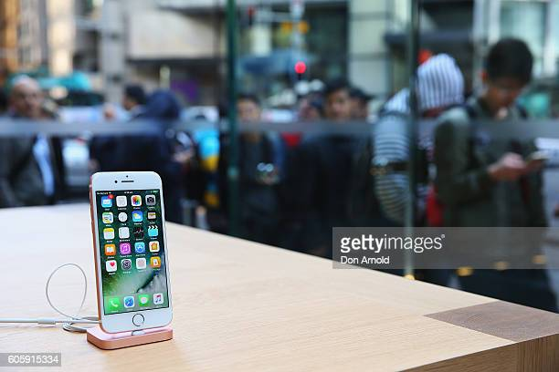 An Apple iPhone 7 is seen displayed inside as crowds wait outside in anticipation for the release of the iPhone 7 at Apple Store on September 16 2016...
