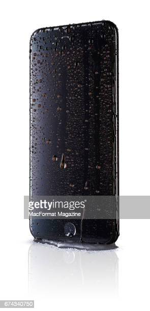 An Apple iPhone 7 Plus with a Black finish covered in droplets of water taken on September 23 2016