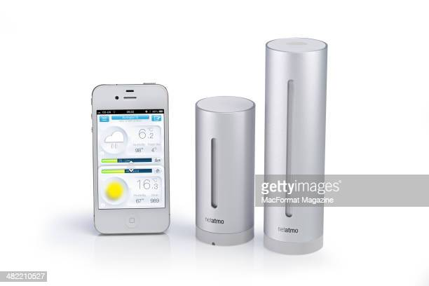 An Apple iPhone and Netatmo Urban Weather Station photographed on a white background taken on May 2 2013