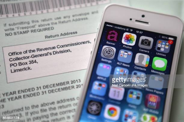 An Apple iPhone beside a tax return form as the Irish Government has said it will pass any test on tax laws after European chiefs launched...