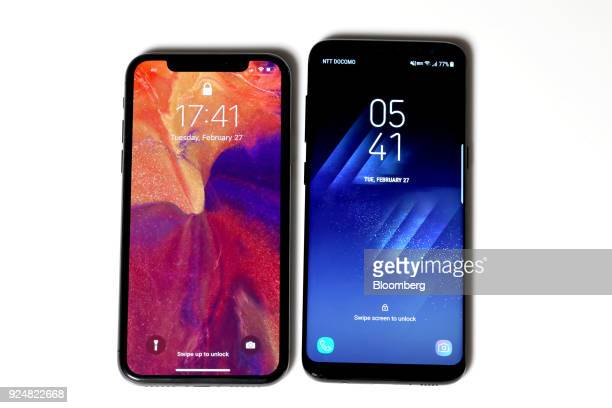 An Apple iPhone X smartphone left and a Samsung Galaxy S8 smartphone are arranged for a photograph in Tokyo Japan on Feb 27 2018 Apple may have led...