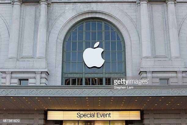 An Apple logo hangs on the outside Bill Graham Civic Auditorium on September 9 2015 in San Francisco California Apple Inc is expected to unveil...