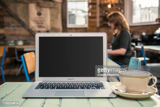 An Apple MacBook Air laptop computer photographed on the table of a coffee shop taken on November 3 2016