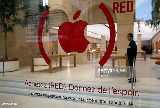 An Apple red logo is displayed for the fight against aids on the facade of the new Apple store SaintGermain during the first opening day on December...