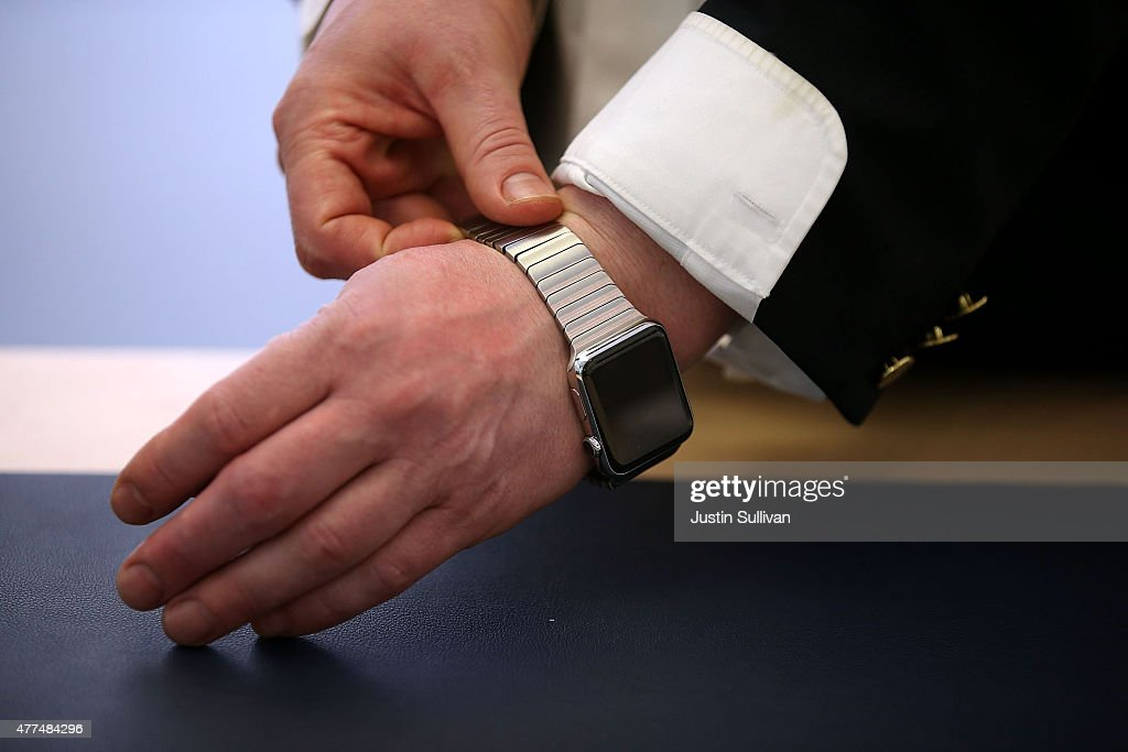 An Apple Store customer tries on a new Apple Watch at the Apple Store on June 17, 2015 in San Francisco, California. Apple began selling the Apple Watch in its stores Wednesday with their reserve and pick up service. Previously the product could only be ordered online.
