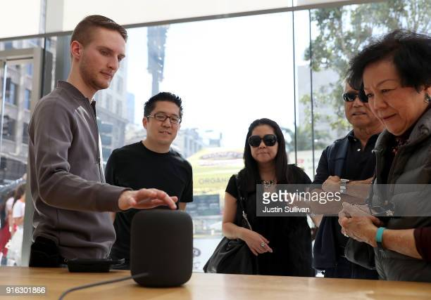 An Apple Store employee demostrates the new Apple HomePod at an Apple Store on February 9 2018 in San Francisco California Apple's new HomePod went...