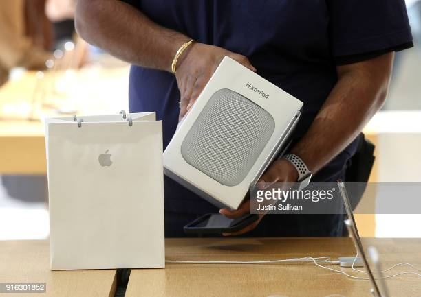 An Apple Store employee prepares to sell a new Apple HomePod at an Apple Store on February 9 2018 in San Francisco California Apple's new HomePod...