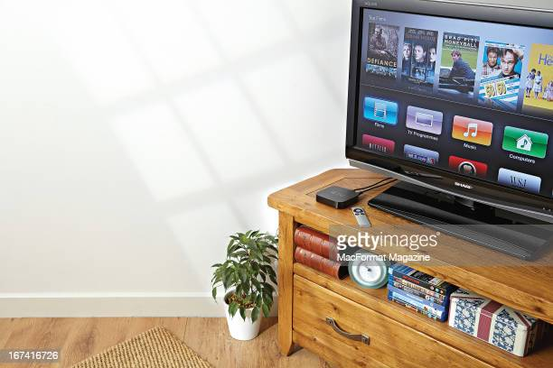 An Apple TV device show connected to a Sharp television in a living room environment photographed during a studio shoot for MacFormat Magazine/Future...