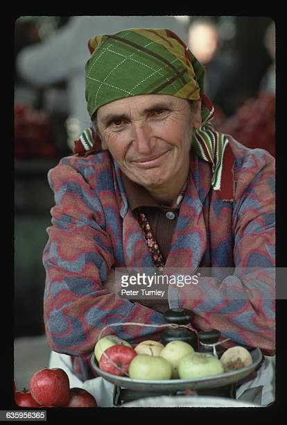 An apple vendor in a T'bilisi fruit market