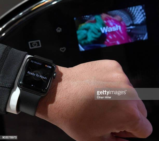 An Apple Watch is displayed in front of a new USD 1699 Whirlpool AllInOne Washer and Dryer at the Whirlpool booth during CES 2018 at the Sands Expo...