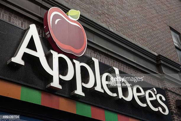 An Applebees restaurant is seen on December 1 2015 in New York City A new sodium warning that includes the logo of a salt shaker printed in menus is...