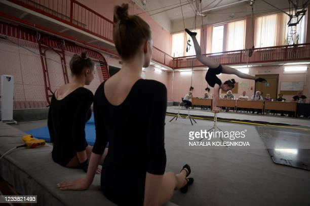 An applicant performs in front of the jury during her admission exam at the circus college in Moscow, on July 5, 2021. - The State College for Circus...
