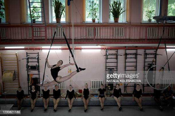 An applicant performs in front of the jury for her admission exam at the circus college in Moscow, on July 5, 2021. - The State College for Circus...