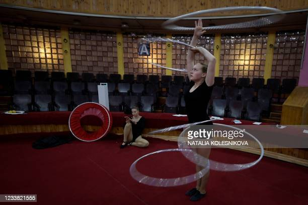 An applicant practises with her hula hoop prior to perform for her admission exam at the circus college in Moscow, on July 5, 2021. - The State...