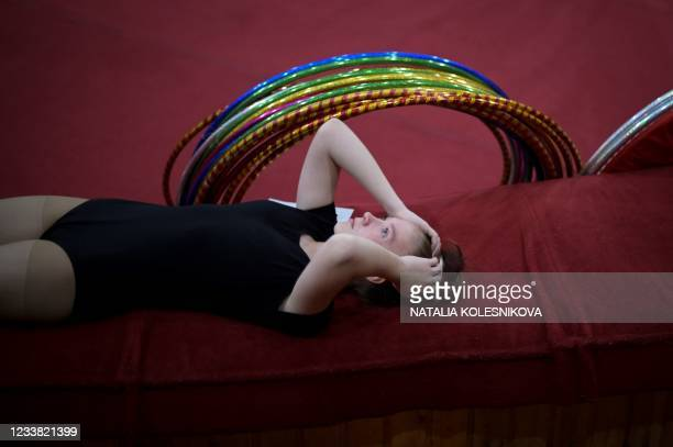 An applicant reacts prior to perform in front of the jury for her admission exam at the circus college in Moscow, on July 5, 2021. - The State...