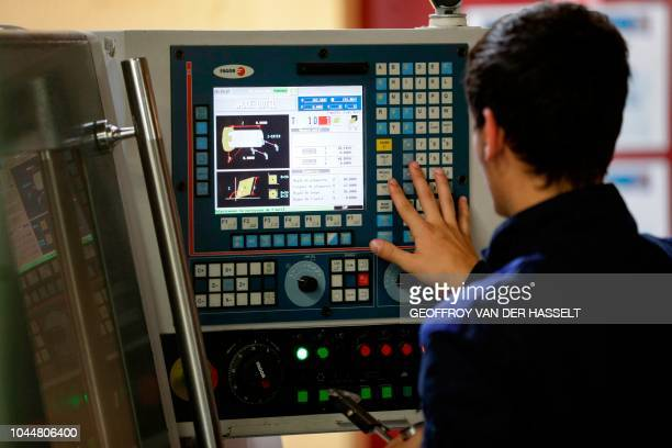 An apprentice works during practical classes at the Essonne apprentice training center in Bondoufle south of Paris on September 27 2018