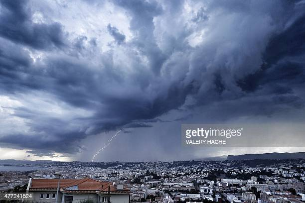 An approaching storm looms over the French riviera city of Nice southeastern France on June 15 2015 AFP PHOTO / VALERY HACHE