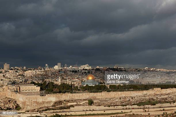 An approaching winter storm begins to cast an ominous shadow over the Old City as seen from the Mount of Olives on February 4 2010 in Jerusalem...