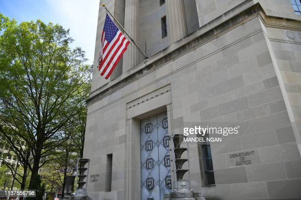 An April 16 2019 photo shows the Department of Justice in Washington DC A redacted version of special counsel Robert Mueller's report into Russian...