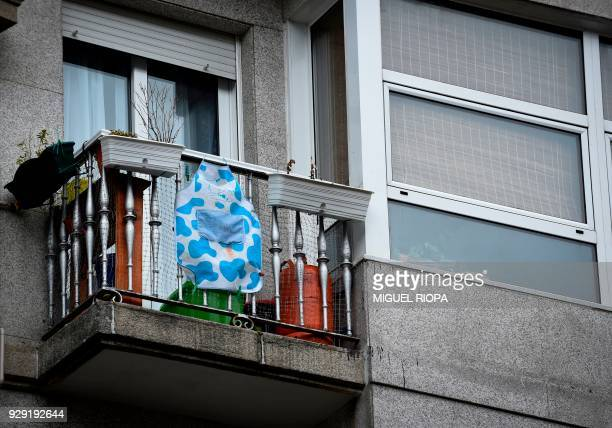 An apron hangs from a balcony to support a one day strike to defend women's rights on International Women's Day in Vigo on March 8 2018 Spain...