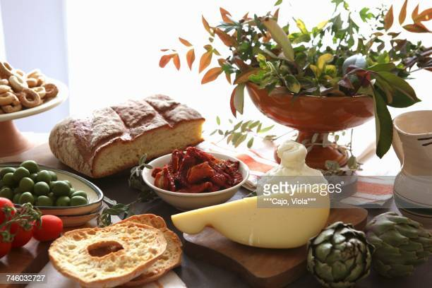 An Apulian arrangement of cheese, bread, pastries and vegetables