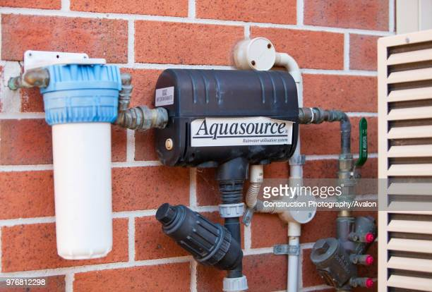 An aquasource pump on a house in Sydney The system pumps rain water collected off the house roof and stored in an underground tank for use in...