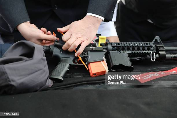 An AR-15 rifle is inspected before a ceremony at the World Peace and Unification Sanctuary in Newfoundland, Pennsylvania on February 28, 2018 in...